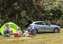 friends camping in new zealand in a jucy rental car