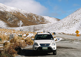jucy car driving in the snow in the south island