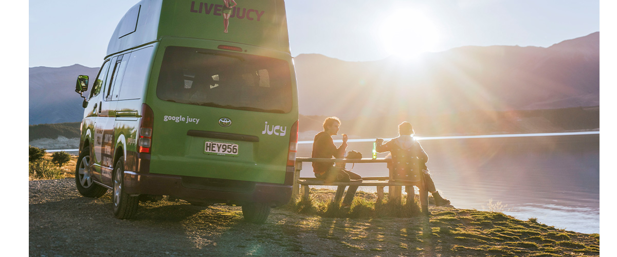 friends camping in jucy campervan in new zealand march